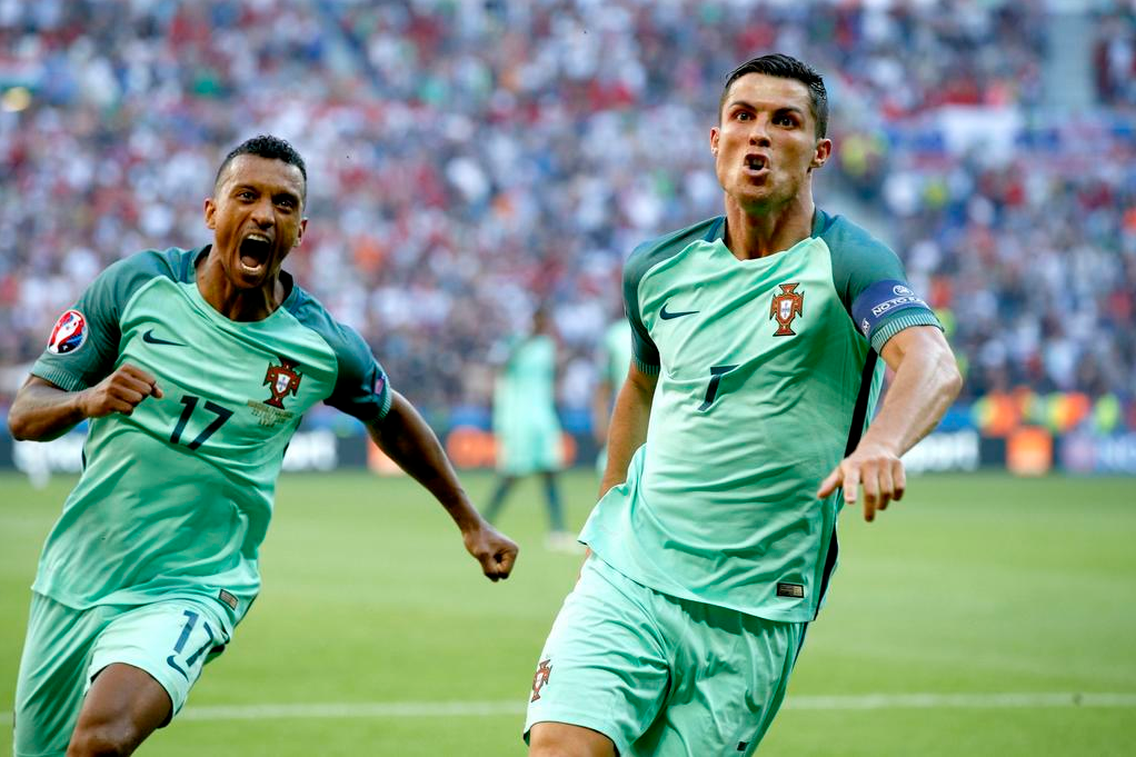 cristiano ronaldo and nani celebrating at euro 2016 semi final